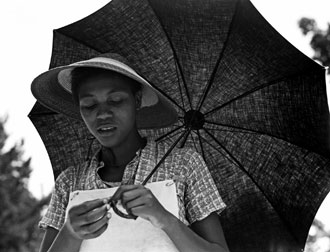 """Girl with umbrella (Louisiana negress)"" (Dorothea Lange, 1937)"
